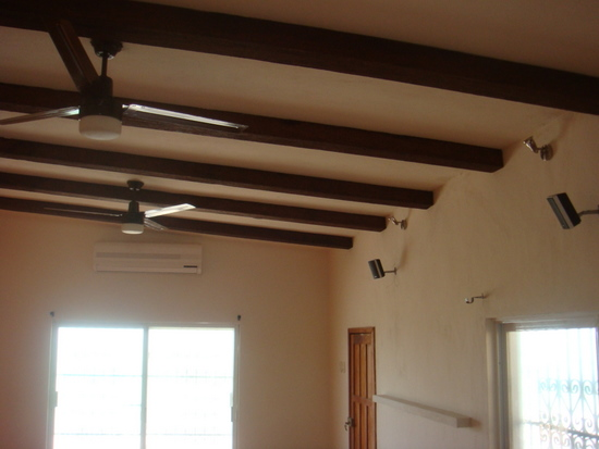 """Another beam glamour-shot. Also visible: the new 36,000 BTU minisplit a/c unit, rear surround sound speakers with buried wiring, spotlights to highlight the beams (can you tell we're proud of them?) and add a little indirect light, and my concrete """"picture rail."""""""